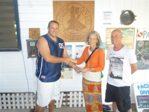 Jizzy Green of KatiKati Kindergarten presenting a donation to PICI